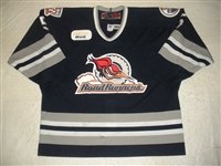 Woywitka, Jeff * <br>Navy Set 1, Photo-Matched<br>Edmonton Roadrunners 2004-05<br>#5 Size: 56